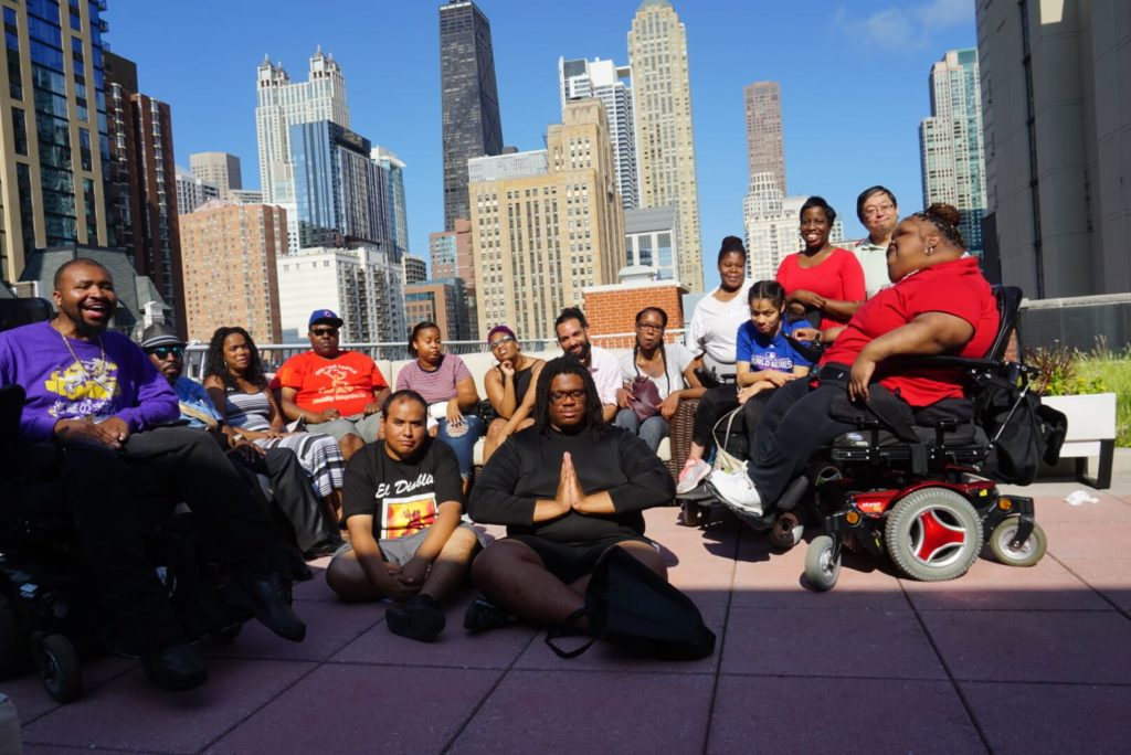 AYLP members pose for a group picture against the Chicago skyline.