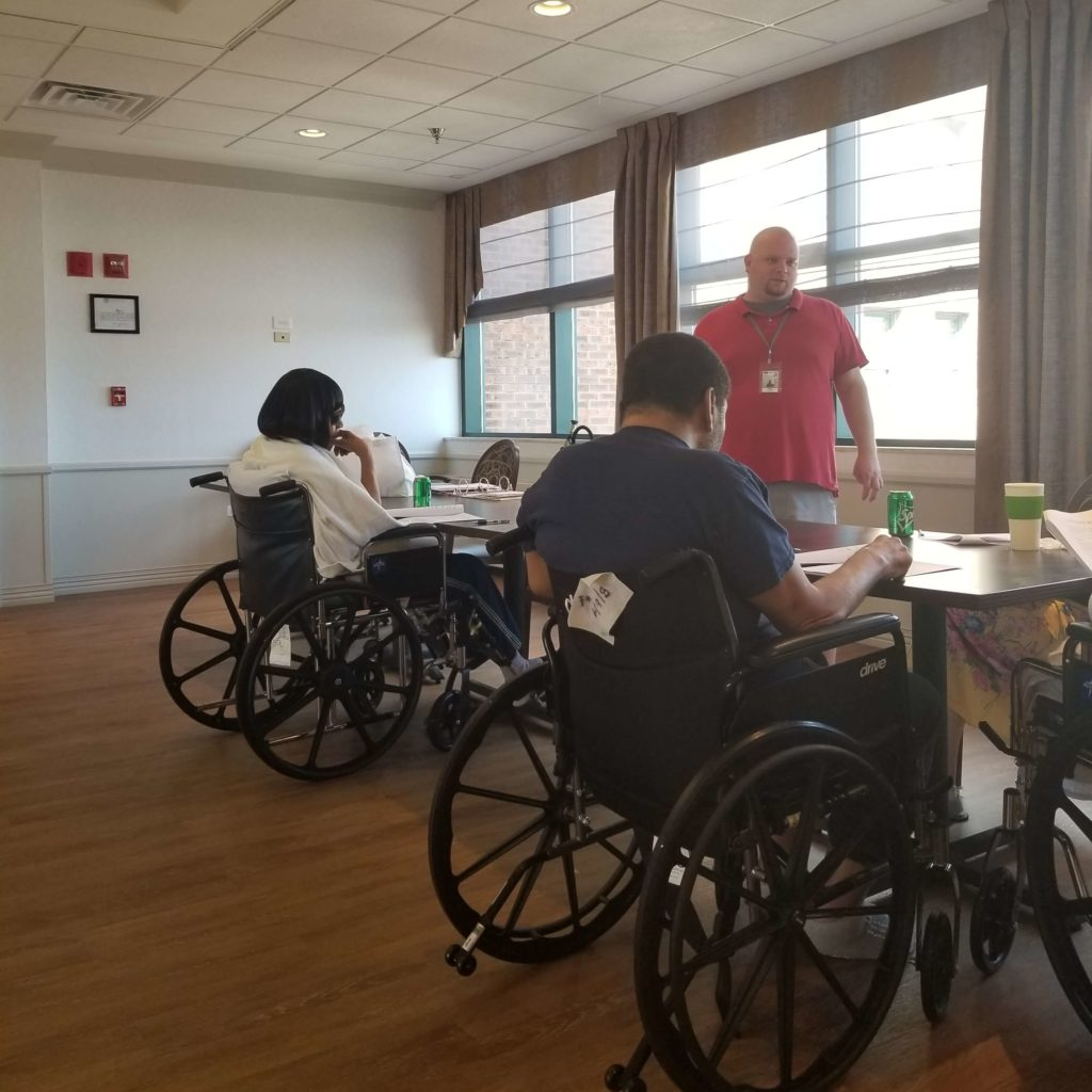 An Access Living instructor teaches nursing home residents about independent living skills.