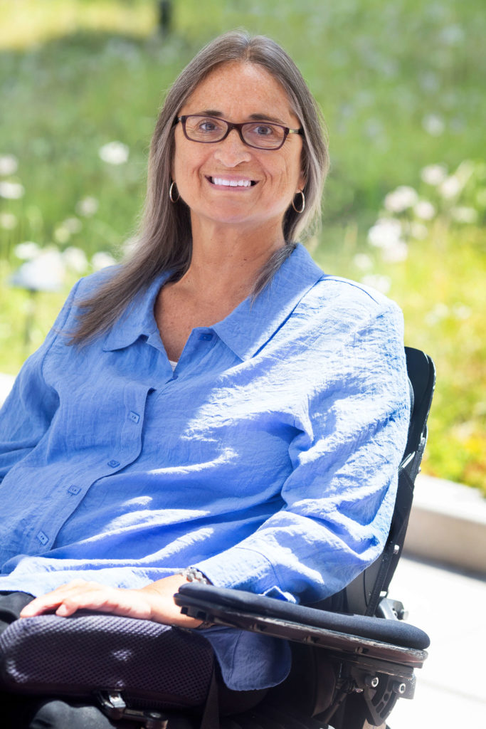 Marca Bristo, a white woman in a power chair.