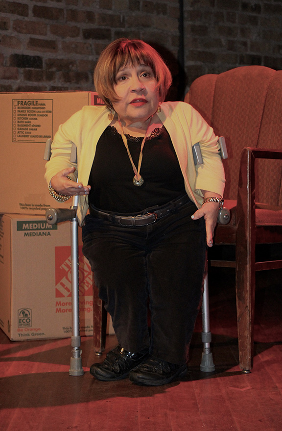 Image is of Tekki Lomnicki, a white woman using forearm crutches, performing in one of her solo shows.