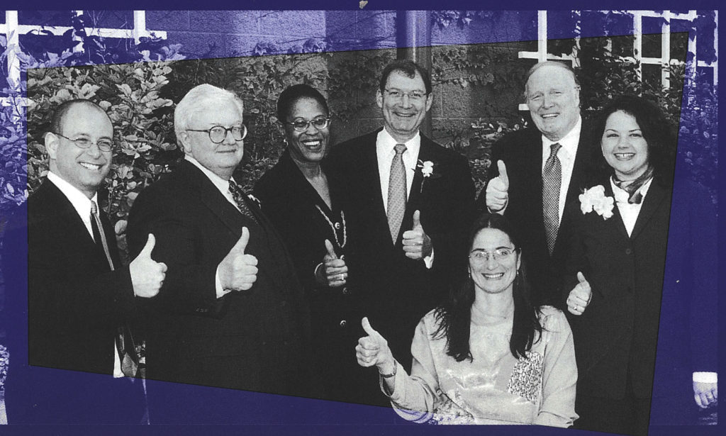 Black and white photo of Marca Bristo, Roger Ebert, and Access Living board members.