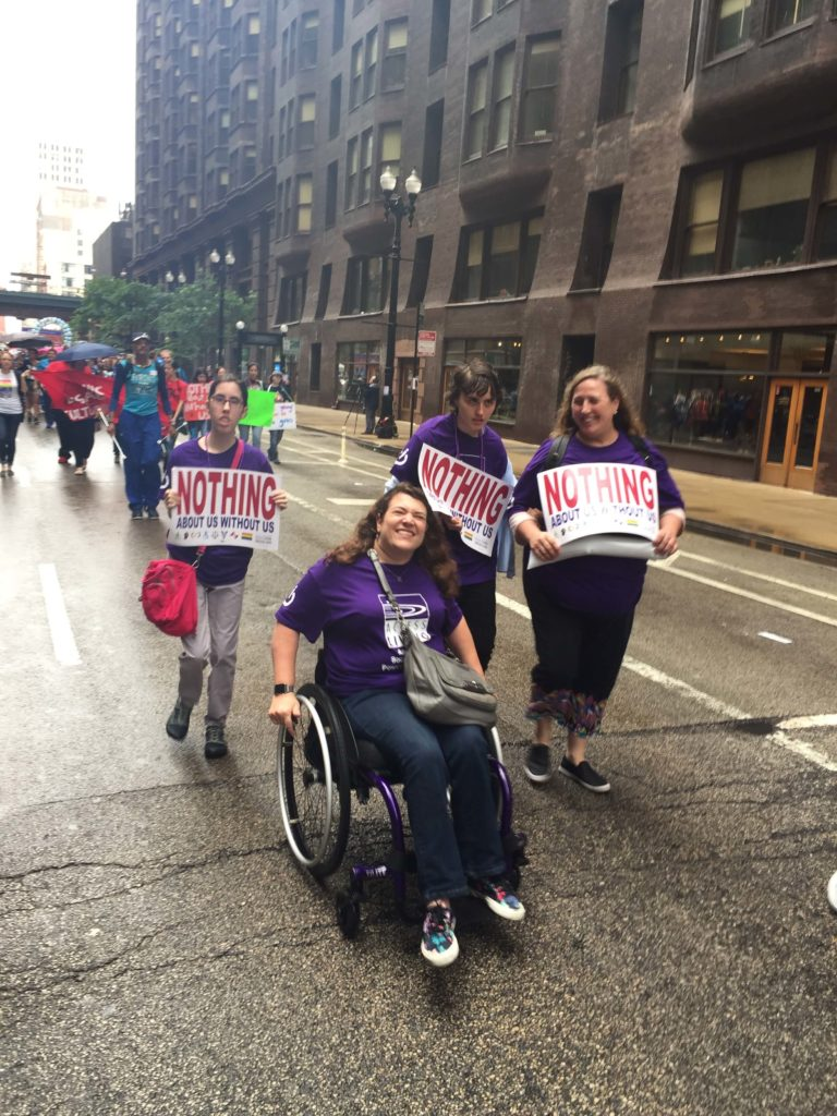 Access Living staff participating in the disability pride parade.