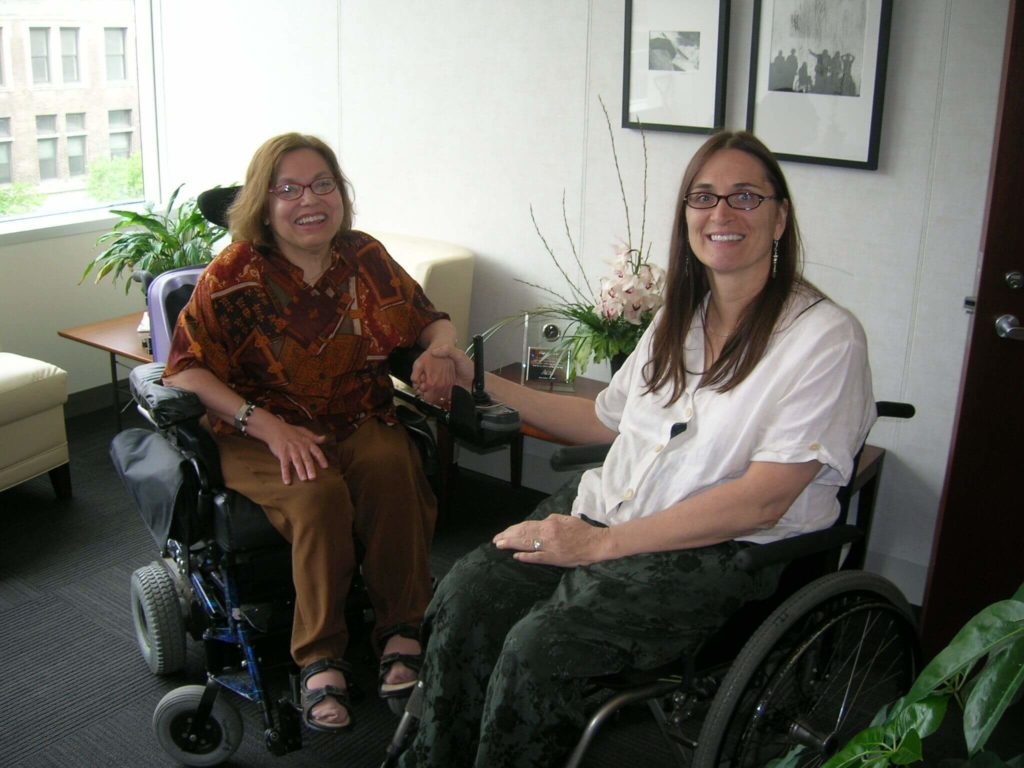 Picutre of Judy Heumann and Marca Bristo. Both are white women and wheelchair users.